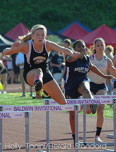 Brownsville's Whitney Petak clears a hurdle in the 300 meter AA girls hurdles